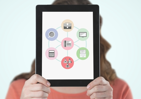 smother: Woman holding digital tablet with business icon in front of her face against white background Stock Photo