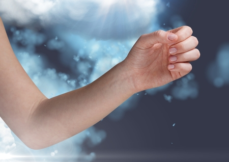 smolder: Digitally generated image of hand against cloud on blue background
