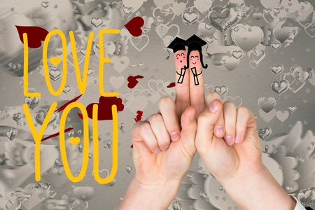 tin can phone: Smiling finger couple in mortarboard, love you message and hearts against white background Stock Photo