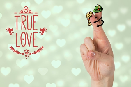 Smiling finger couple with true love message against digitally generated hearts background Stock Photo