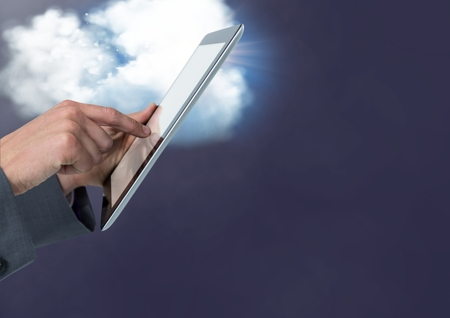 smolder: Hand of businessman using digital tablet against digitally generated cloud background