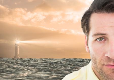 Digital composite of Sad man next to hopeful lighthouse