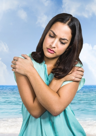 dreariness: Digital composite of Sad young woman against beach sea