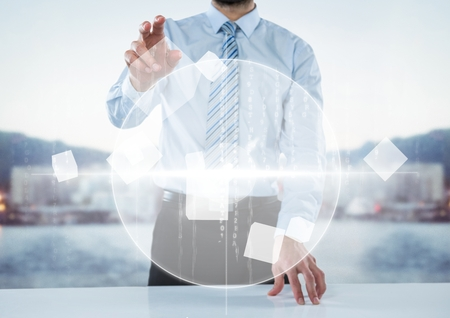 touch sensitive: Digital composite of Business man at desk with white interface against blurry skyline Stock Photo