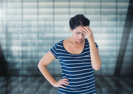tied in: Digital composite of Stressed woman against windows
