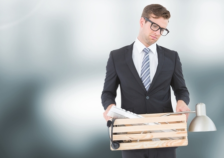 dreariness: Digital composite of Sad redundant man job loss against blurred background