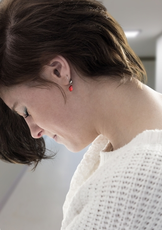 dreariness: Digital composite of Sad young woman against hospital corridor