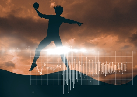 Digital composite of Silhouette and white graph with flare against orange sky