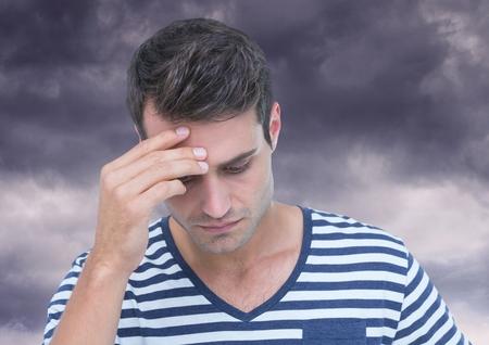 dreariness: Digital composite of Depressed stressed man against dark clouds