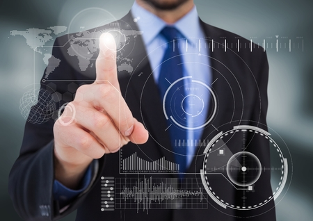 well dressed: Digital composite of Business man pointing at white interface with flare in blurry grey room
