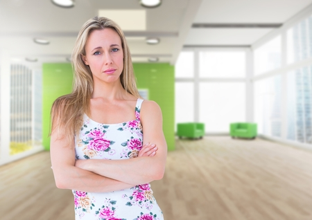 Digital composite of Sad woman in empty office