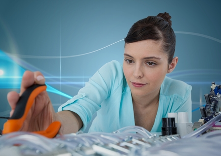 pliers: Digital composite of Woman with electronics and pliers against blue background with waves