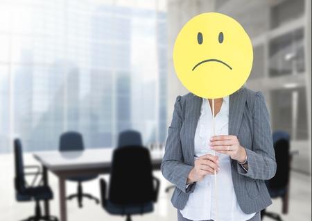 Digital composite of Sad businesswoman against office meeting room