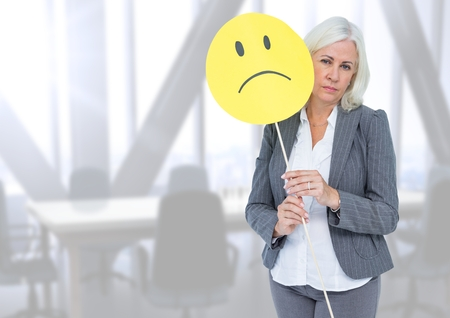 dreariness: Digital composite of Sad businesswoman against bright office