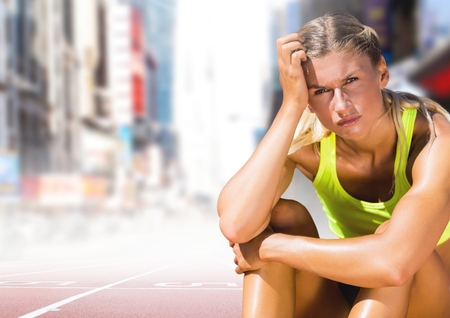 dreariness: Digital composite of Sad disappointed athlete runner sitting down in city