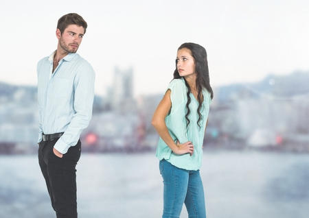 Digital composite of Sad couple parting against cold city Stock Photo
