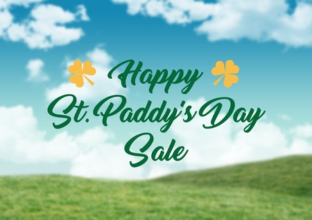 Digital composite of Patricks Day graphic against grass and sky Stock Photo