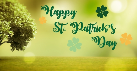 irish landscape: Digital composite of Patricks Day graphic against green grass and tree