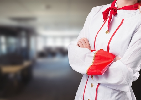 Digital composite of Chef arms folded against blurry restaurant