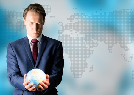 Digital composite of Man with globe against blue map Stock Photo