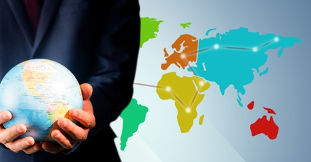 Digital composite of Close up of travel agent holding globe against map with lights