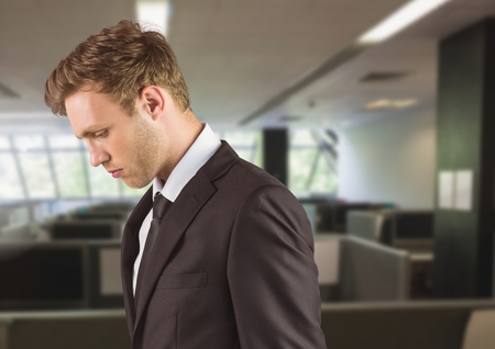 gloominess: Digital composite of Sad disappointed businessman in office Stock Photo