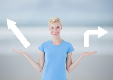 Digital composite of Woman choosing or deciding left or right arrows with open palm hands Stock Photo