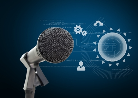 Digital composite of Microphone against blue background with technology interface Stock Photo