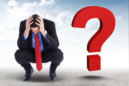 uneasy: Digital composite of Worried businessman with 3d question mark on his side