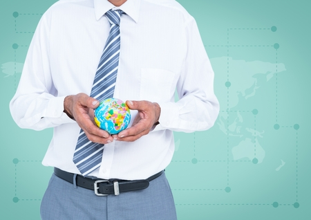 Digital composite of Travel agent mid section holding globe against green map