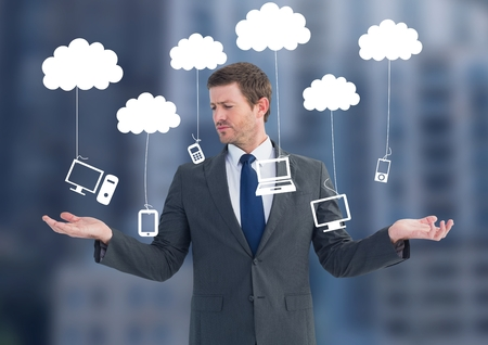 dangling: Digital composite of Man choosing or deciding clouds hanging technology with open palm hands Stock Photo