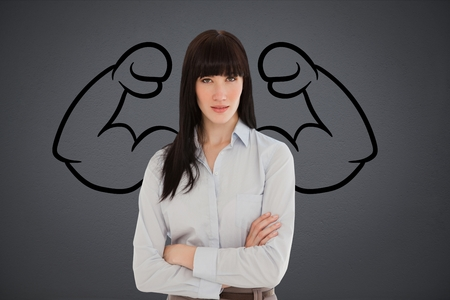 Digital composite of Confident business woman against grey background with drawing of  flexing muscles