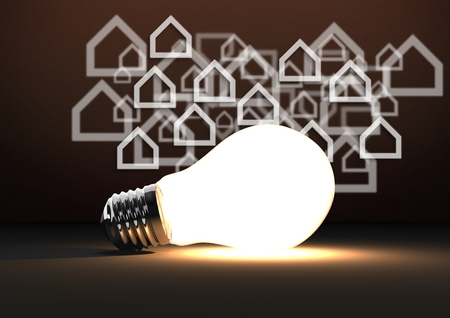 Digital composite of 3D bulb against brown background with home icons Stock Photo