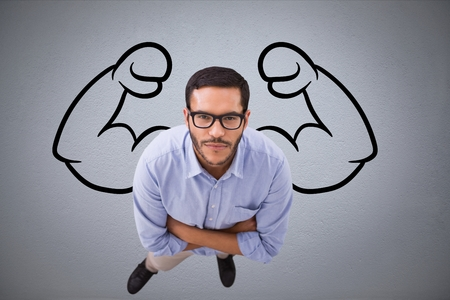Digital composite of Aerial view of confident business man  against grey background with drawing of  flexing muscles 版權商用圖片