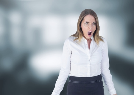 Digital composite of Shocked disgusted woman against grey background Stock Photo