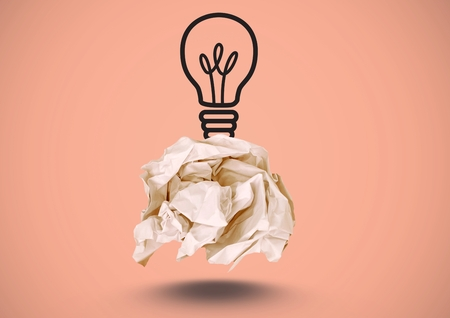 Digital composite of Crumpled paper with lightbulb drawing with pink background
