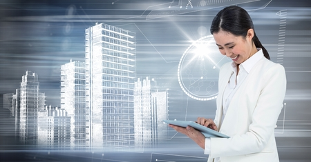 Digital composite of Woman with tablet and white building graphic against motion blur