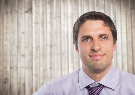 Digital composite of Close up of man in lavendar shirt against blurry wood panel Stock Photo