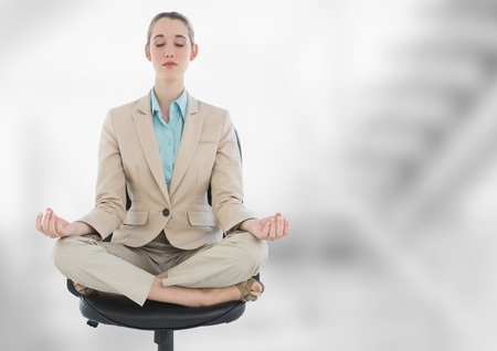 Digital composite of Businesswoman Meditating with bright background