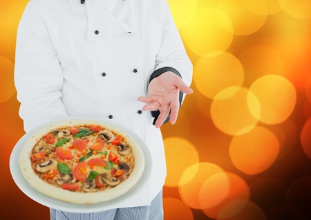 Digital composite of Chef with pizza against blurry orange bokeh