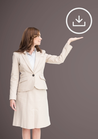 well dressed woman: Digital composite of Woman with Open palm hand under download icon
