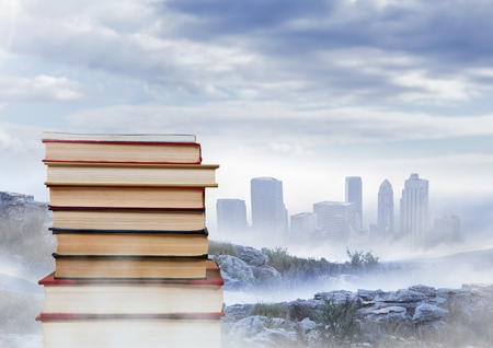 literacy: Digital composite of Books stacked by distant city