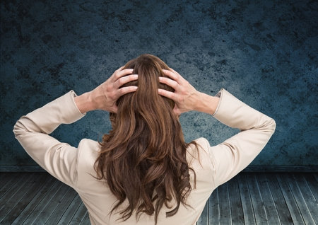 floorboards: Digital composite of Stressed woman holding head by blue wall Stock Photo