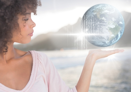 multiracial: Digital composite of Woman with open palm hand holding world earth globe interface Stock Photo