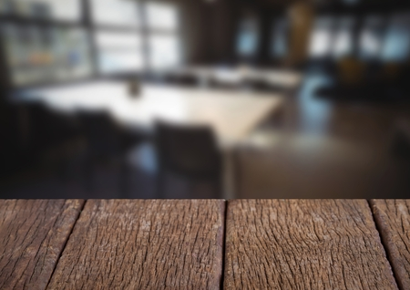 Digital composite of Wood table against blurry cafe