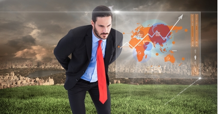 Digital composite of Businessman looking at interface of world map with City background Stok Fotoğraf