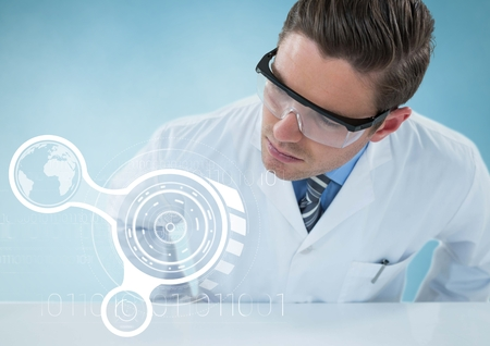 Digital composite of Man in lab coat leaning over table looking at white interface against blue background