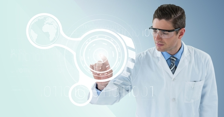 Digital composite of Man in lab coat and goggles pointing at white interface and flare against blue background