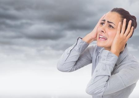 暗い雲を強調した女性のデジタル合成 写真素材