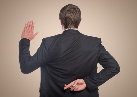 Digital composite of Back of business man with hand up and fingers crossed against cream background Фото со стока